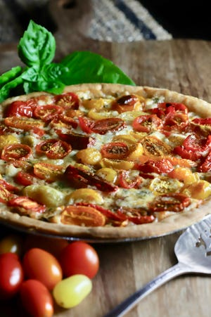 Cherry Tomato Pie garnished with basil.