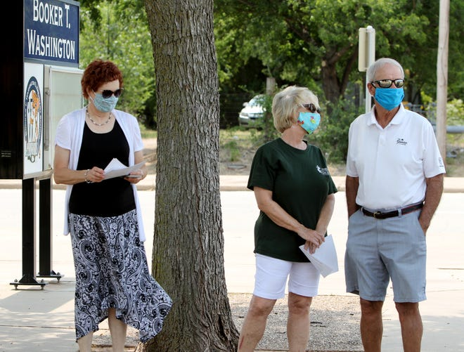 Members from First United Methodist Church of Wichita Falls  lead a prayer for WFISD Sunday, Aug. 16, 2020, at Booker T. Washington Elementary School.