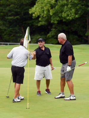 Warsaw native Brad Baker is congratulated Rich Bubenchik, left, and Larry Snode after winning the Zanesville District Golf Association Senior Amateur title on Saturday at Zanesville Country Club. Baker had three rounds of 70 or better, including a final-round 67.