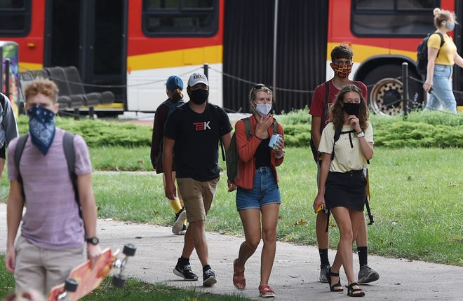 Iowa State University students walk to their classes during the first day of classes at the university central campus Monday, Aug. 17, 2020, in Ames, Iowa.
