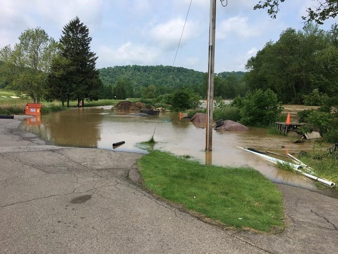 Country Club Drive was blocked off by flooding May 29 as a result of a massive rain storm. Three Beaver County municipalities will participate in this year's Local Climate Action Program to develop climate action plans alongside area college students.  [Patrick O'Shea/BCT file]