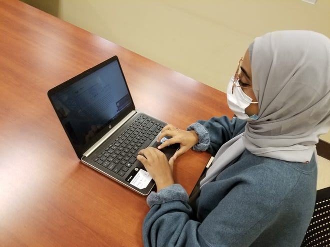 "Student Malak ""Angel"" Ali said she is happy to attend class on Fletcher's campus again. ""I'm the type of person who likes to be in class, do class work, I like to talk to teachers, see them and communicate with them,"" she said Monday."