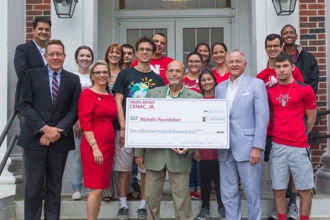"Houma businessman Arlen ""Benny"" Cenac Jr.  joins Nicholls students and officials to mark his $1.2 million to the Thibodaux university."