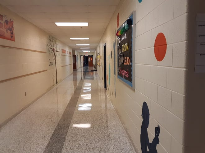 The hallways of Charles England Elementary School are empty on the first day of class as the Lexington City School system begins the school year with remote learning.