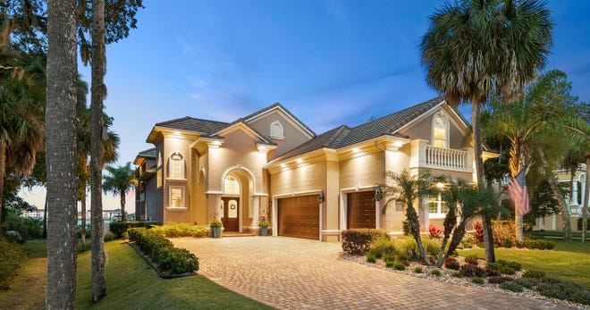 This home, on South Riverwalk Drive in Palm Coast Plantation, sold recently for $955,000. It has four bedrooms and four baths in 3,600 square feet of living space. Built on almost a half-acre lot on the Intracoastal Waterway in 2011, the house also has a gourmet kitchen, a screened pool and spa with a summer kitchen and gas fireplace, a covered boathouse, a three-car garage, a balcony and a home office. [Photo provided by Trademark Realty Group LLC]