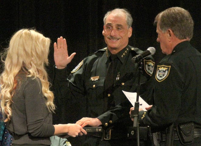 """Volusia County Sheriff Mike Chitwood, being sworn in here in 2017, says the changes brought by Amendment 10 haven't cost taxpayers """"a dime,"""" at least not those involving his office, the property appraiser, clerk of court and elections supervisor."""