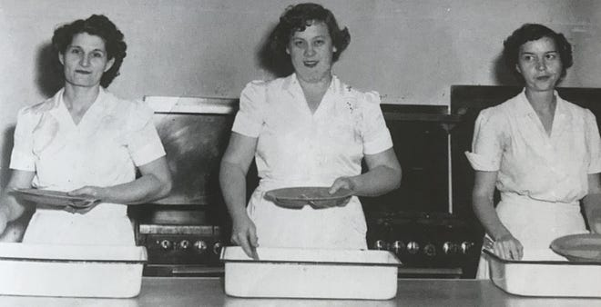 The 1953 Bunnell High School lunchroom staff is pictured, left to right: Nellie Mae Taylor, Norma Turner (lunchroom manager), and Babe Irwin. In 1952, there were fewer than 400 students in grades 1-12, all housed in the BHS building. These women were in charge of providing them all with a fresh lunch. [Flagler County Historical Society]