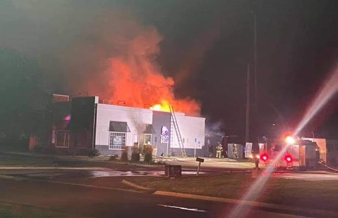 Mount Pleasant firefighter battle a blaze Sunday at the KFC-Taco Bell restaurant in Mount Pleasant. The restaurant was a total loss.