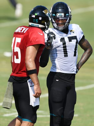 If the Jaguars offense is to be more productive this season, it will need big seasons from quarterback Gardner Minshew III (left) and wide receiver DJ Chark (right).