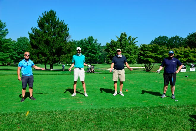 From left: John Lucerne, Jacob Nissle, Jim Shoemaker and Michael Gormley, a foursome from AmeriHealth Caritas, at Lenape Valley Foundation's 11th annual golf outing fundraiser.
