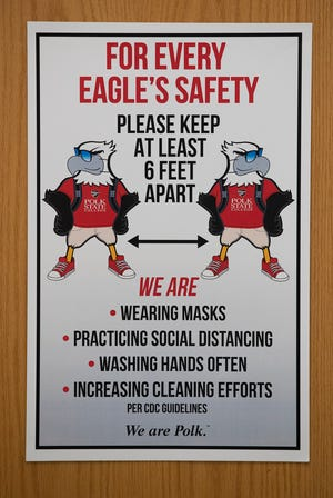 A sign instructs returning students of Polk State College's safety protocols in August 2020.