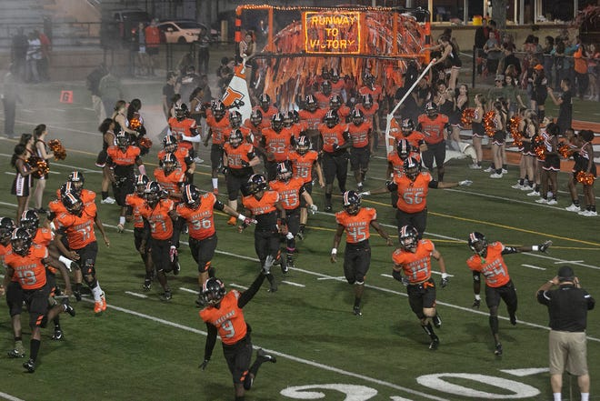 The Lakeland High School Dreadnaughts take the field against Port St. Lucie Centennial last year. Polk County teams can start practicing on Aug. 26 with the first football games to be played on Sept. 11. [MICHAEL WILSON/LEDGER CORRESPONDENT]
