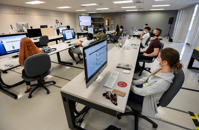 Polk State College students listen to a lecture in the Introduction to Digital Media class in the Lakeland Technology Building during the first day of classes at the Lakeland Campus of Polk State College in Lakeland Fl. Monday August 17, 2020. ERNST PETERS/THE LEDGER