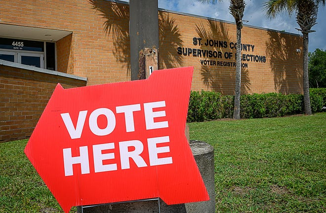 A sign directs early voters into the St. Johns County Supervisor of Elections office in St. Augustine on Monday, August 17, 2020. Because today is primary election day, the election office is not a polling station but regular precinct polling stations are open from 7 a.m. to 7 p.m. countywide.