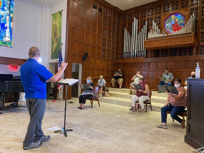 Joseph Caulkins leads a rehearsal of the online Come Together Chorus, presented by Key Chorale for bringing singers together virtually.