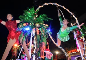 Sarasota Circus wows the crowd at the Holiday Parade. Thousands of spectators turned out for the 2019 24th Annual Sarasota Holiday Parade Saturday evening on Main Street in Sarasota. The parade this year has been canceled [HERALD-TRIBUNE ARCHIVE PHOTO / CARLA VARISCO]