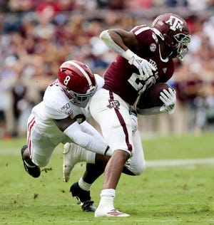 Alabama linebacker Christian Harris (8) makes a tackle on Texas A&M running back Isaiah Spiller (28) during the first half at Kyle Field Saturday, Oct. 12, 2019 in College Station, Texas. [Staff Photo/Gary Cosby Jr.]