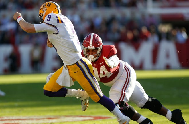Alabama defensive lineman DJ Dale (94) dives to try to tackle LSU quarterback Joe Burrow (9) during the first half of Alabama's game with LSU Saturday, Nov. 9, 2019. [Staff Photo/Gary Cosby Jr.]