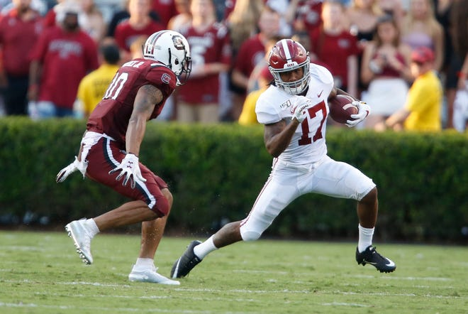 South Carolina defensive back R.J. Roderick (10) makes a tackle on Alabama wide receiver Jaylen Waddle (17) during Alabama's 47-23 victory over South Carolina in Columbia Saturday, Sept. 14, 2019. [Staff Photo/Gary Cosby Jr.]
