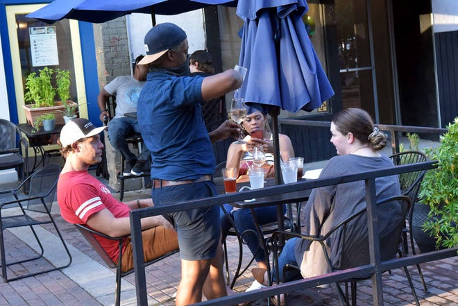 Blue Moon Cafe on Hay Street is one of several restaurants downtown that offers outdoor dining. [Ed Clemente for The Fayetteville Observer]