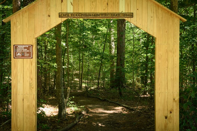 The entrance to the Cape Fear Mountain Bike Trail off the Cape Fear River Trail on Tuesday, August 11, 2020. Parks facilities are open during Phase 3 COVID-19 restrictions. Capacity limitations remain in place for indoor facilities and size limitations for mass gatherings for both indoors and outdoors.