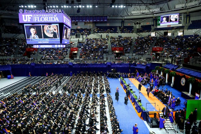 University of Florida students take part in a Fall Commencement Ceremony at the Exactech Arena in Gainesville on Dec. 14, 2019. [Brad McClenny/The Gainesville Sun]