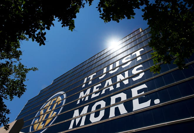 "The SEC slogan ""It Just Means More."" is displayed on the windows of the Hyatt Regency Wynfrey Hotel as the first day of SEC Football Media Days begins in Hoover on July 10, 2017. [Tuscaloosa News/Erin Nelson]"