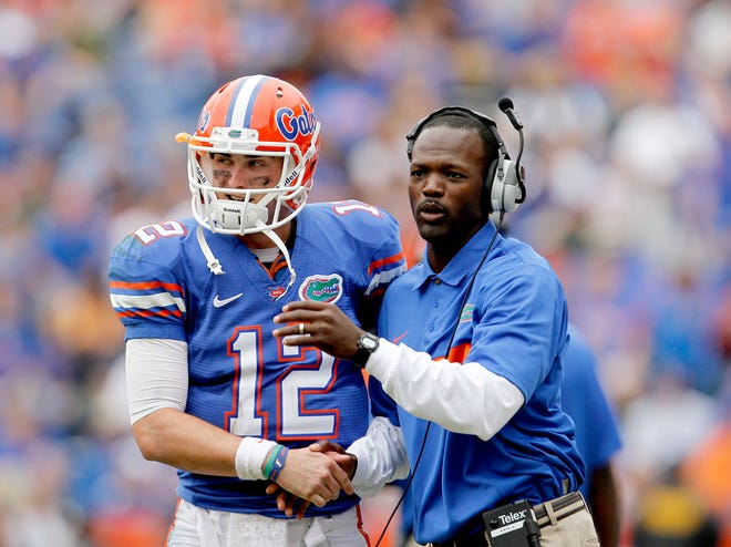 Florida quarterback John Brantley talks with wide receivers coach Aubrey Hill during the Nov. 19, 2011 game against Furman at Ben Hill Griffin Stadium. [File]