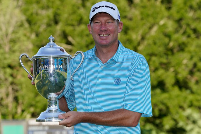 Jim Herman poses with the Sam Snead Cup on Sunday after winning the Wyndham Championship at Sedgefield Country Club.