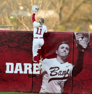 Left fielder Alexis Mack leaps on the wall but can't reach a home run as the Crimson Tide played Wichita State in the Easton Bama Bash in Rhoads Stadium Friday, Feb. 21, 2020.  [Staff Photo/Gary Cosby Jr.]