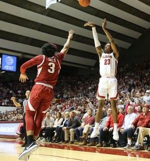 Arkansas guard Desi sills (3) defends as Alabama guard John Petty Jr. (23) lofts a three point shot in Coleman Coliseum Saturday, Feb. 1, 2020. [Staff Photo/Gary Cosby Jr.]
