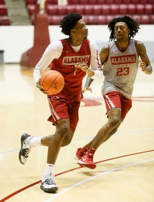 Alabama guard Herb Jones (1) brings the ball up against Alabama guard John Petty Jr. (23) practice for the Alabama men's basketball team Wednesday, Oct. 16, 2019. [Staff Photo/Gary Cosby Jr.]