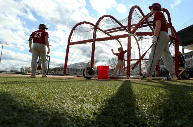 The Alabama baseball team opened practice Friday, Jan. 24, 2020. Players wait their turn for batting practice. [Staff Photo/Gary Cosby Jr.]