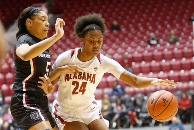 South Carolina forward Victaria Saxton (5) defends as Alabama guard De'Sha Benjamin (24) drives into the lane while the Crimson Tide hosted the Gamecocks Sunday Jan. 5, 2020 in Coleman Coliseum. [Staff Photo/Gary Cosby Jr.]