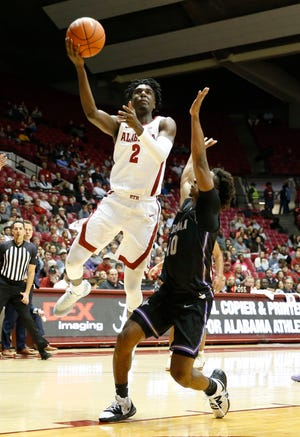 Alabama guard Kira Lewis Jr. (2) penetrates to the hoop against Furman guard Alex Hunter (10) in Coleman Coliseum Tuesday, Nov. 19, 2019. [Staff Photo/Gary Cosby Jr.]