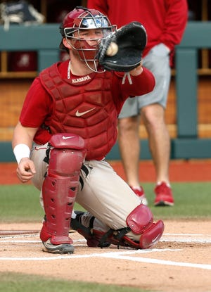The Alabama baseball team opened practice Friday, Jan. 24, 2020. Catcher Sam Praytor takes a throw at the plate. [Staff Photo/Gary Cosby Jr.]