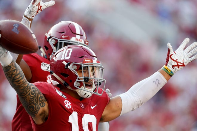 Alabama linebacker Ale Kaho (10) celebrates with Alabama linebacker Ben Davis (1) after Kaho recovered a blocked punt for a touchdown during the second half of Alabama's 59-31 victory over Ole Miss Saturday, Sept. 28, 2019. [Staff Photo/Gary Cosby Jr.]