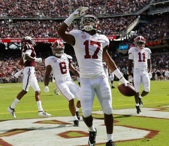 Alabama wide receiver Jaylen Waddle (17) celebrates with teammates after scoring a touchdown against Texas A&M during the first half at Kyle Field Saturday, Oct. 12, 2019 in College Station, Texas. [Staff Photo/Gary Cosby Jr.]