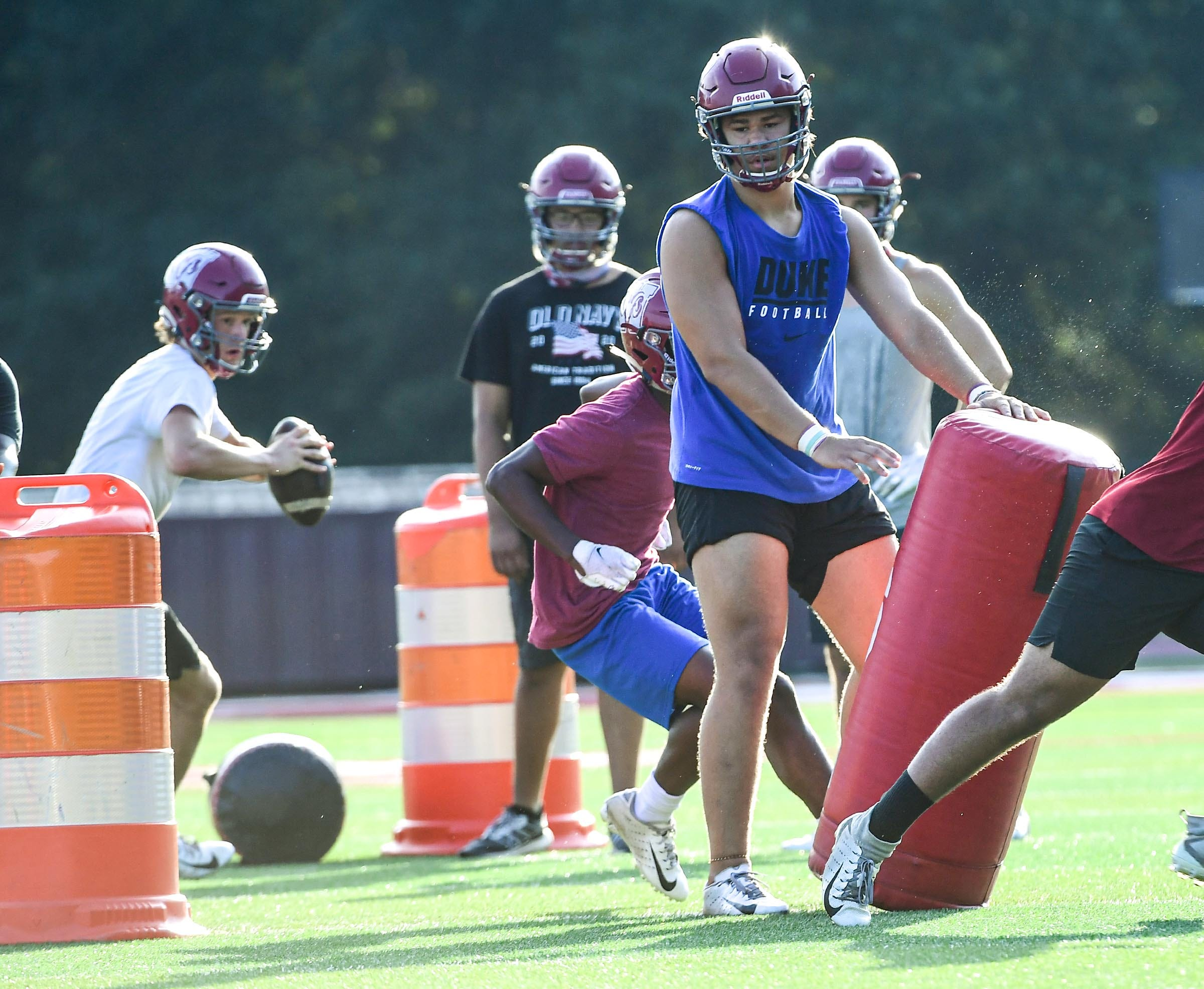 Westside senior Jayden Ramsey, a Appalachian State University commit, blocks with other offensive lineman teammates for quarterback Owen Skelton during phase 1.5 football workouts, the first with helmets in Anderson Monday, August 17, 2020.
