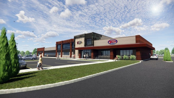 Evergreen Heights' first building will house Tom's Drive In and Holidays Pub & Grill. The new development on Richmond Street, east of Meijer, will begin construction in the fall of 2020 or spring 2021.