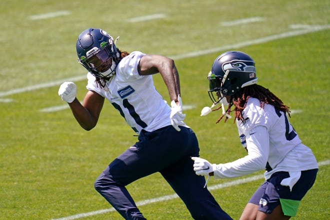 Seattle Seahawks cornerback Tre Flowers, left, is trailed by cornerback Shaquill Griffin Thursday, Aug. 13, 2020, as they take part in a practice during an NFL football training camp in Renton.