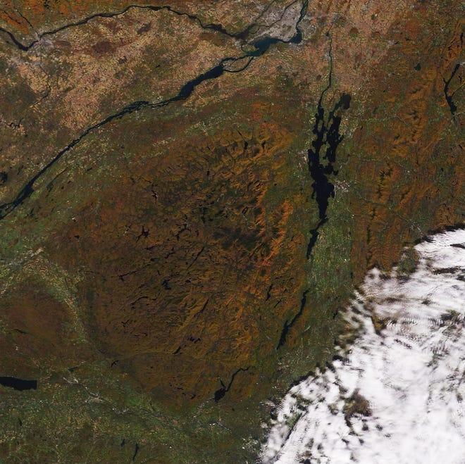 Turning tree foliage is seen on both sides of Lake Champlain from this NASA satellite image taken Oct. 11, 2019 and processed by the Space Science and Engineering Center, University of Wisconsin-Madison.