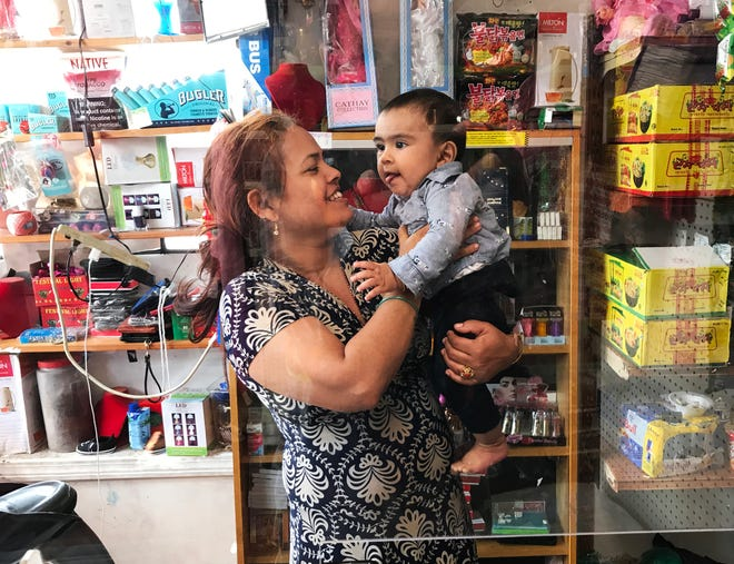 Sabitra Phuyel, owner of Nepali Dumpling House in Burlington, Vt., holds her 7-month-old son, Prayash. The Nepali Dumpling House will close at the end of August after nearly four years because of a steep decline in business during the COVID-19 pandemic.
