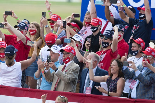 People cheer as President Trump speaks at a campaign event Monday, August 17, 2020, at Wittman Regional Airport in Oshkosh, Wis.