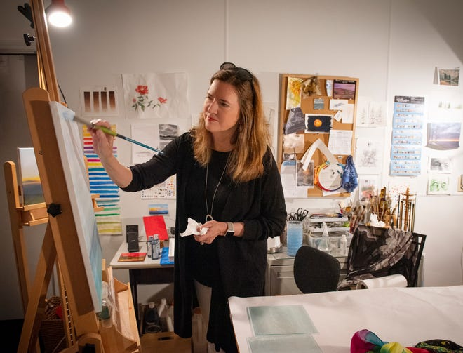 Elizabeth Troutman paints in her studio at McCalister Square in Greenville.