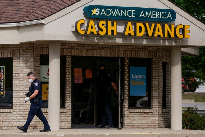 Lafayette Police investigate a robbery at Advance America, 1806 Elmwood Ave., Monday, Aug. 17, 2020 in Lafayette.