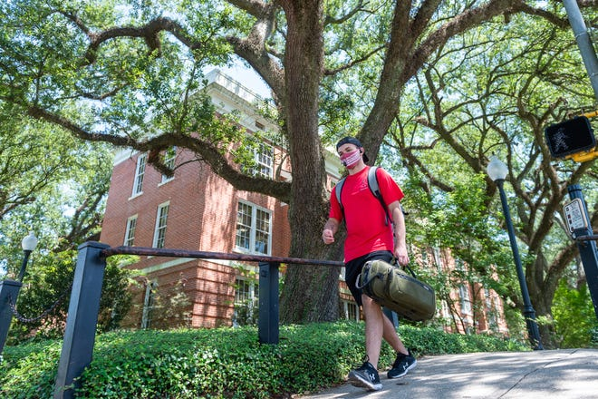 Drake Bourgerois, walking to class as students return to campus for the fall semester at the University of Louisiana at Lafayette. The first week at UL ended with five COVID-19 cases and students adjusting to new rules.