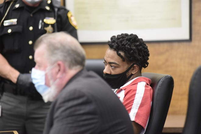 Dajuan Midgett, 30, sits next to his attorney, Steven Billing, before being sentenced to prison for 18 to 23 1/2 years.
