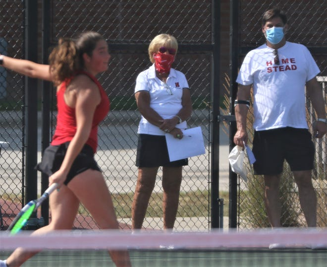 Homestead tennis coaches Jackie Egelhoff, center, and Jason Diamond look on as senior Kate Wade and the Homestead girls tennis team began its first practices on Monday, Aug. 17, 2020. Wade is a three-time state qualifier in doubles, having qualified with three different partners during her freshman, sophomore and junior seasons.
