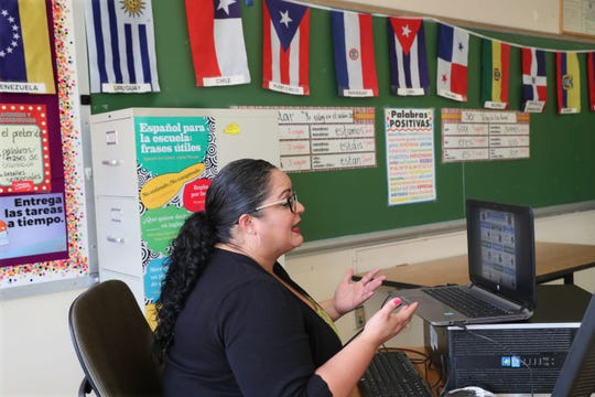 Teacher Marielle Rivera teaches 8th grade Spanish class via the internet from her desk at Milwaukee School of Languages August 17, 2020.  Milwaukee Public Schools held a press conference there to highlight its virtual start.  Students at more than 40 schools will start the year virtually due to COVID-19.  This school is on the early start calendar.  It teaches five languages, plus standard classes and 13 Advanced Placement subject classes.  Hosting grades 6-12 it would normally have 1,150 students in the school.  Some staff are using the building to teach and others are teaching their classes from home.  All virtual.